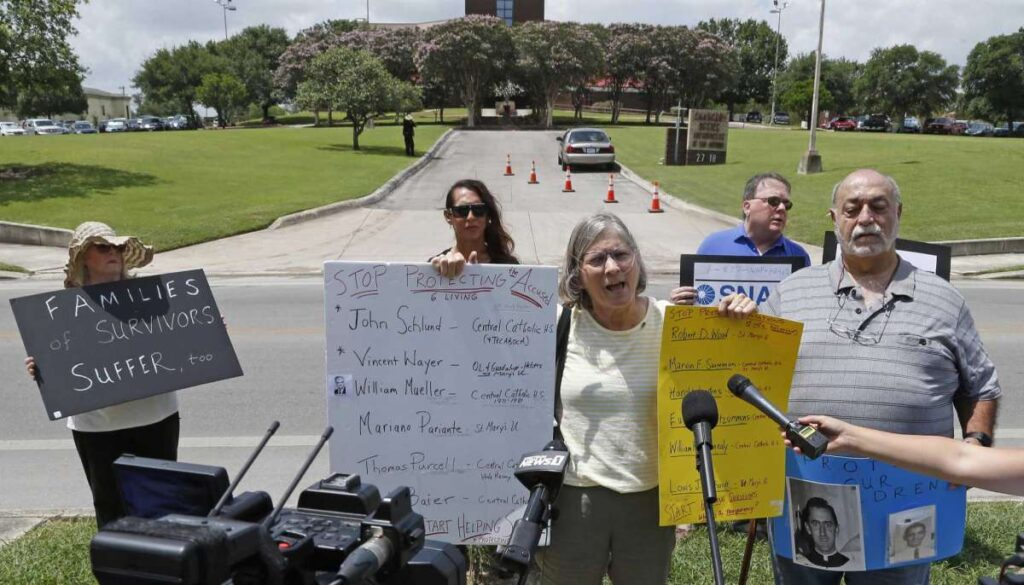 Patty Koo and Zac Zepeda, on her right, talk to media as the Survivors Network of those Abused by Priests call for action by Archbishop of San Antonio Gustavo García-Siller and St. Mary's University President Thomas Mengler during a news conference outside the Archdiocese of San Antonio on Wednesday.  Ronald Cortes /Contributor