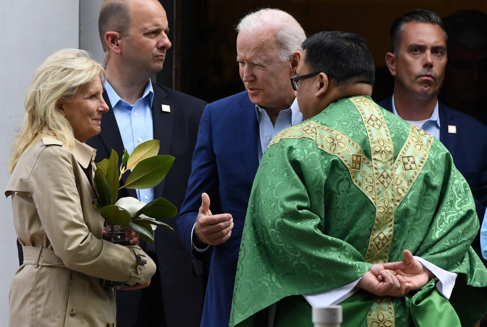 US President Joe Biden (C) and First Lady Jill Biden (L) speaks with a priest as they leave St. Joseph on the Brandywine Catholic Church in Wilmington, Delaware, June 19, 2021. U.S. Roman Catholic bishops issued a challenge on June 18 to President Biden over his support for abortion rights, agreeing to draft a statement on the meaning of holy communion which could potentially be used to deny the sacred rite to the U.S. leader. (Olivier DOULIERY/AFP via Getty Images)