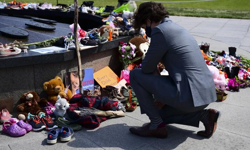 Canadian Prime Minister Justin Trudeau visits a memorial at the Eternal Flame on Parliament Hill in Ottawa on Tuesday, June 1, 2021, that's in recognition of discovery of children's remains at the site of a former residential school in Kamloops, British Columbia. (Sean Kilpatrick/The Canadian Press via AP)Canadian Prime Minister Justin Trudeau visits a memorial at the Eternal Flame on Parliament Hill in Ottawa on Tuesday, June 1, 2021, that's in recognition of discovery of children's remains at the site of a former residential school in Kamloops, British Columbia. (Sean Kilpatrick/The Canadian Press via AP)