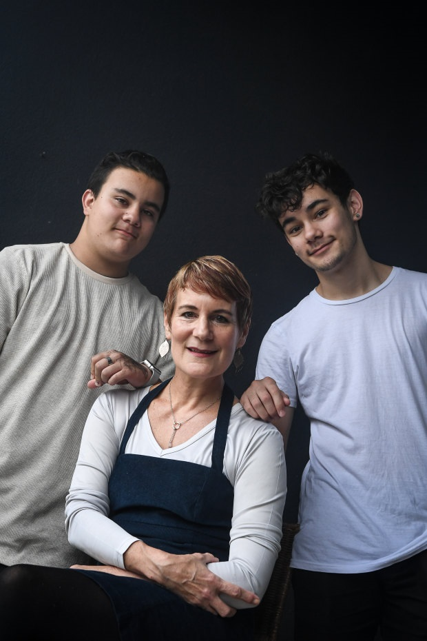 Xanana Gusmao's ex-wife, Kirsty Sword Gusmao, with two of their sons Daniel, left, and Alexandre, who have sent letters of support to Daschbach's accusers.CREDIT:JUSTIN MCMANUS