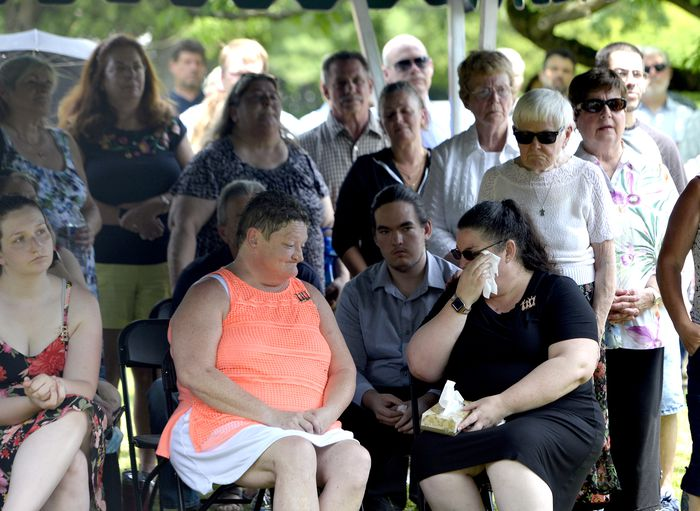 Members of the Croteau family held a graveside memorial service for Danny Croteau, the 13-year-old altar boy authorities determined was killed by his parish priest in 1972. The ceremony was held at Danny's grave in Hillcrest Cemetery in Springfield, June 28, 2021. (Don Treeger / The Republican)