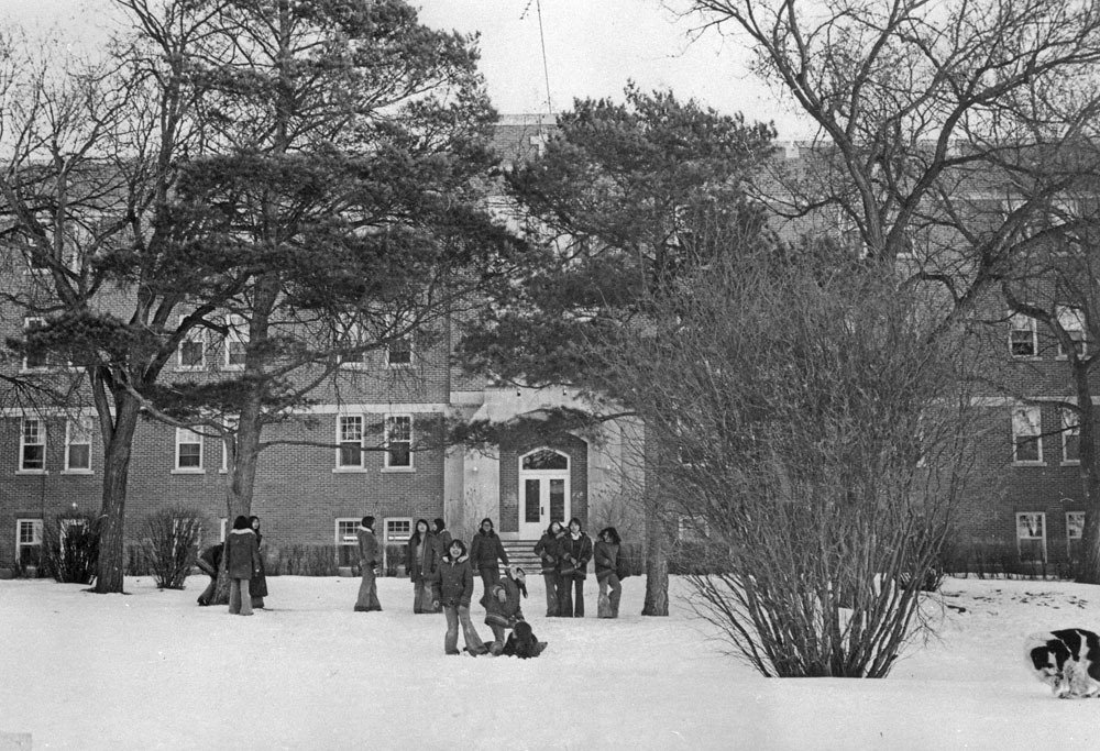 A group of students in front of the Fort Qu'Appelle Indian Residential School in Lebret, Sask., in March 1973. Photo via Library and Archives Canada