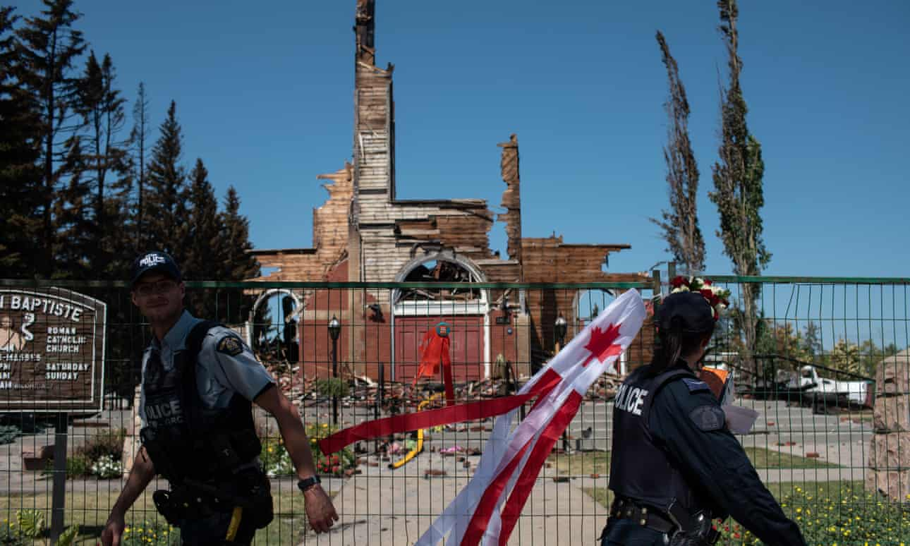 Firefighters inspect the damage at the burned-out Roman Catholic St Jean Baptiste church in Morinville, Alberta, Canada. Photograph: Anadolu Agency / Getty Images