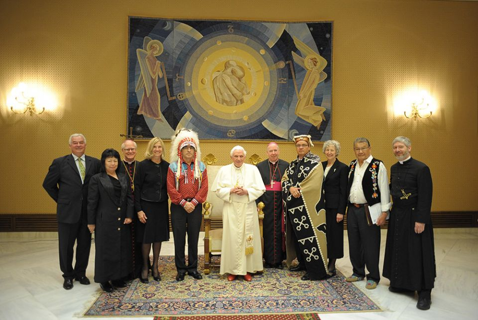 Pope Benedict XVI poses with representatives of students at the former Indian residential schools and the church in Canada at the Vatican April 29, 2009. (CNS/L'Osservatore Romano)