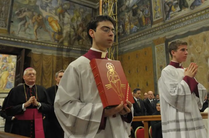 Martinelli holds a missal during the newly-elected Pope Francis' first Mass inside the Sistine Chapel on March 14, 2013. (Vatican Media)
