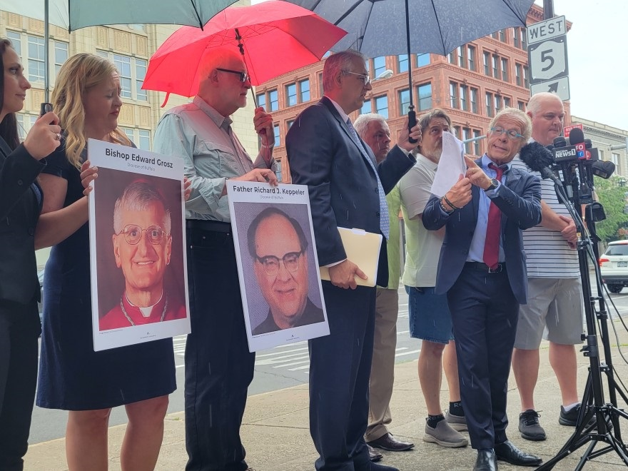 ttorneys and abuse survivors stand across the street from the Catholic Diocese of Buffalo July 13, 2021 to discuss a Child Victims Act lawsuit that alleges retired Auxiliary Bishop Edward Grosz and the late Rev. Richard Keppeler of abusing a 15-year-old boy three decades ago.