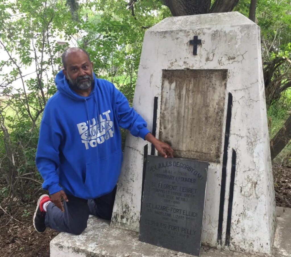 Joseph Kuruvilla, the parish priest at St. Philip's Roman Catholic Church, sought permission from the Archbishop of Regina to remove the plaque. (Submitted by Madeleine Whitehawk)