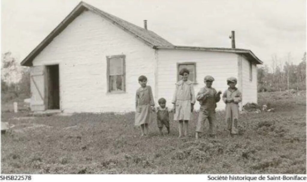 Indigenous boys in front of the St. Philip's Indian Residential School in the 1930s before the school was expanded. (Société historique de Saint-Boniface)