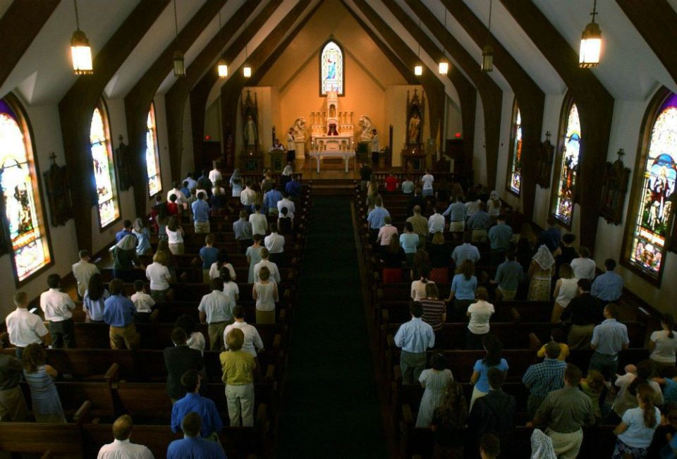 People attend Mass at Christendom College in Front Royal, Virginia, April 3, 2003. (Newscom/The Washington Times/ZUMAPRESS.com)