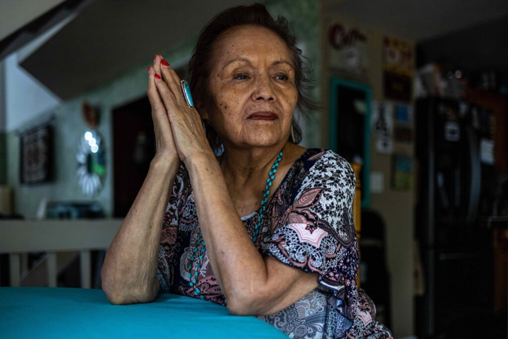 """Bessie Smith, 79, was forbidden to speak her Navajo language once she began attending a federal boarding school, and she nearly forgot her native tongue. """"It's so casually taken away,"""" she said. """"It's like you are violated.""""Credit...Sharon Chischilly for The New York Times"""