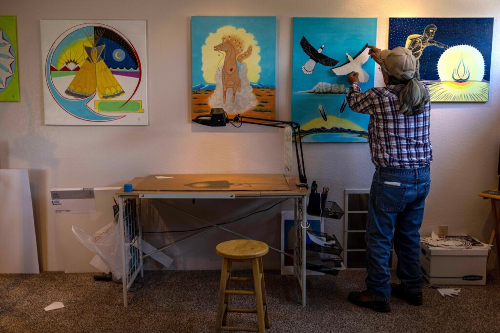 Russell Box Sr. spends his days at his home in Ignacio, Colo., painting images of Native American symbols and ceremonies he was told to forget at the boarding school he attended as a child.Credit...Sharon Chischilly for The New York Times