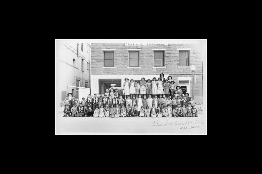 Tolani Lake School children and staff in an undated photograph.Credit...National Archives