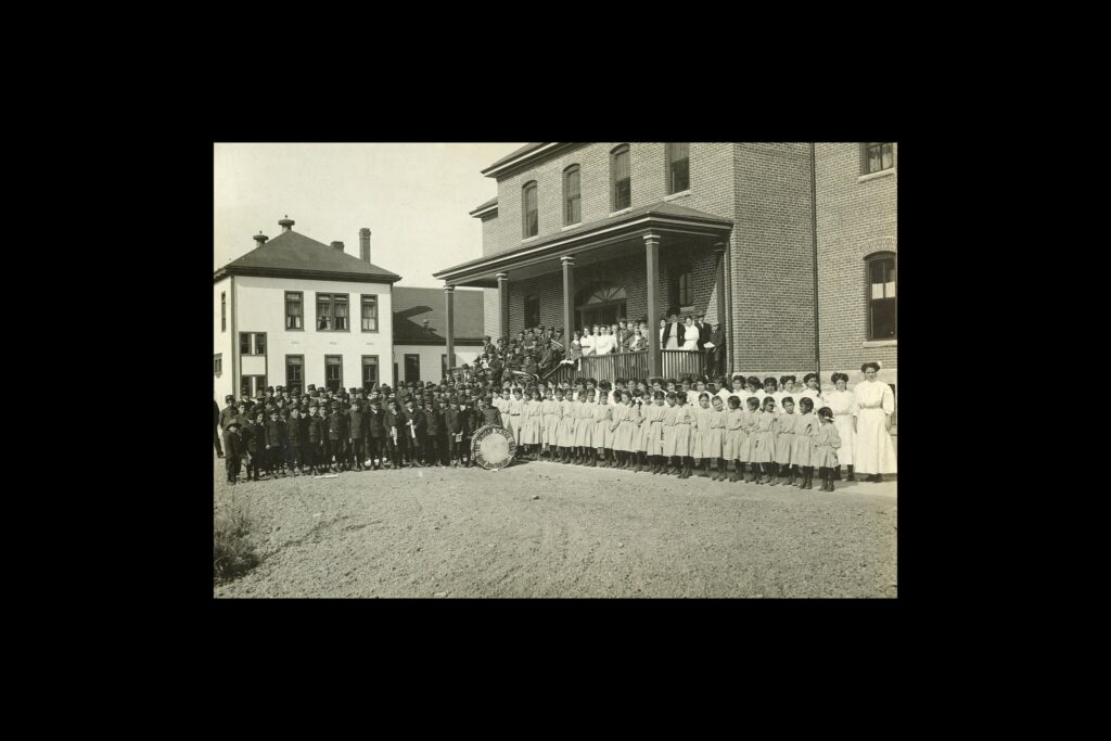 [Students and staff at Grand Junction Indian School in western Colorado in an undated photograph.Credit...Museums of Western Colorado]