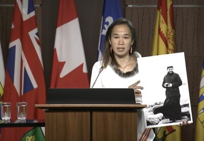 [Nunavut MP Mumilaaq Qaqqaq holds a photo of French Oblate priest Joannis Rivoire, who is accused of sexually assaulting Inuit children who attended residential schools in Nunavut communities in the 1960s. The NDP is calling on the government to investigate Rivoire and other alleged perpetrators within the residential school system. (Screenshot courtesy of CPAC)]