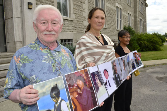 Residential school survivor Piita Irniq, human rights advocate Lieve Halsberghe and supporter Susie Utatnaaq stand before the Oblate-owned home in Ottawa in 2016 to protest the Oblate order's 200th anniversary that year. (File photo by Jim Bell)