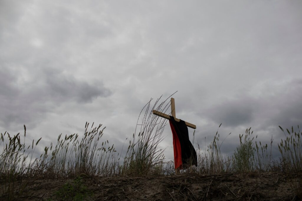 This dress hanging on a cross represents the children who died at the Kamloops Indian Residential School. Amber Bracken for The New York Times