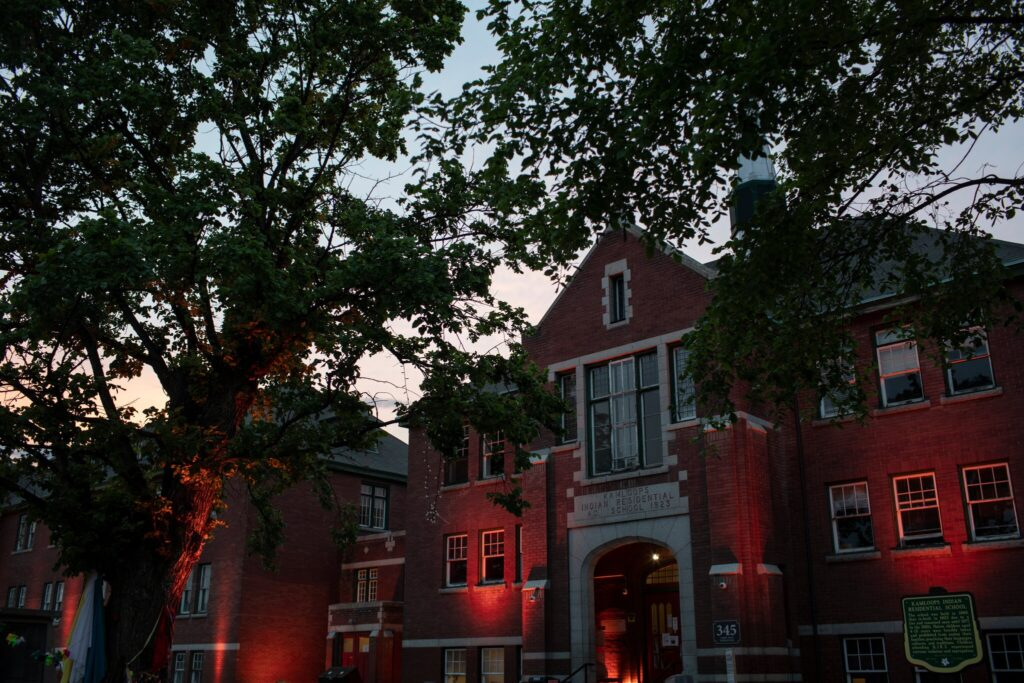 The former Kamloops Indian Residential School in British Columbia is lit with orange lights, in honor of the children whose bodies were discovered there. Amber Bracken for The New York Times