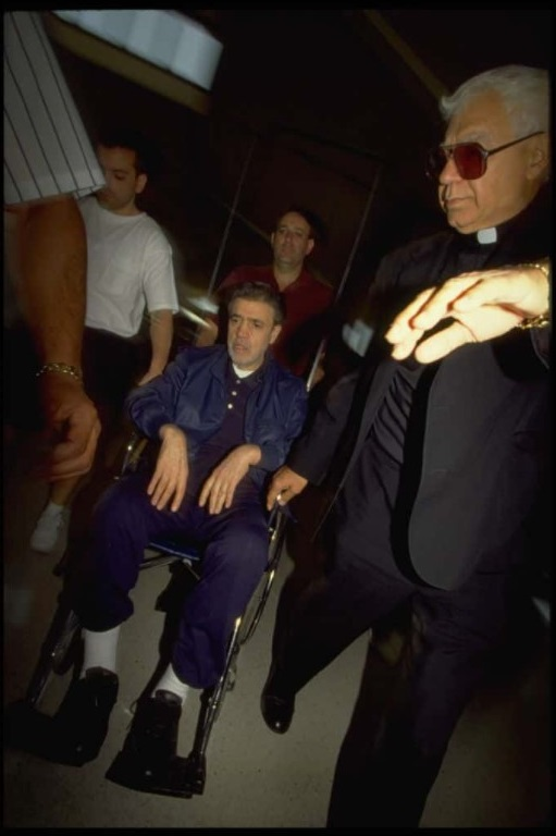 Father Louis Gigante (R) seen escorting his brother Vincent Gigante (C) in a wheelchair (Rick Maiman / Sygma via Getty Images)
