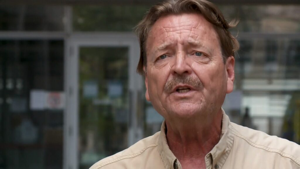 Survivor John Lousteau outside New Orleans' federal courthouse on Saturday, July 31, 2021. Photo by T.J. Pipitone, WWL-TV.