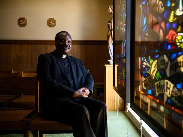 Father Wilbroad Mwape, the pastor and administrator of St. Anthony of Padua Catholic Church, poses for a portrait in the school chapel Thursday, Aug. 6, 2020. (Josh Morgan / Staff)