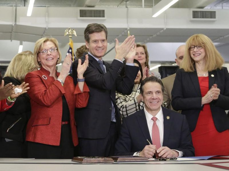 New York State Governor Andrew Cuomo is seen signing of the Child Victims Act in the offices of the NY Daily News in New York on February 14, 2019. (Mark Woodward/New York Daily News)]