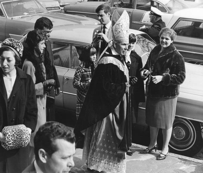 In this file photo from 1968, Bishop Fulton J. Sheen, center, greets some Peoria friends shortly after celebrating Mass at St. Patrick's Church while commemorating the parish's 100th anniversary. - C. MERCER/JOURNAL STAR FILE