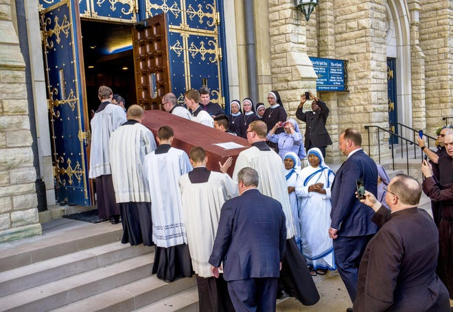 The casket bearing the remains of Archbishop Fulton Sheen is carried into St. Mary's Cathedral in Peoria on Thursday, June 27, 2019, completing the transfer that began before dawn at St. Patrick's Cathedral in New York. - Journal Star File Photo