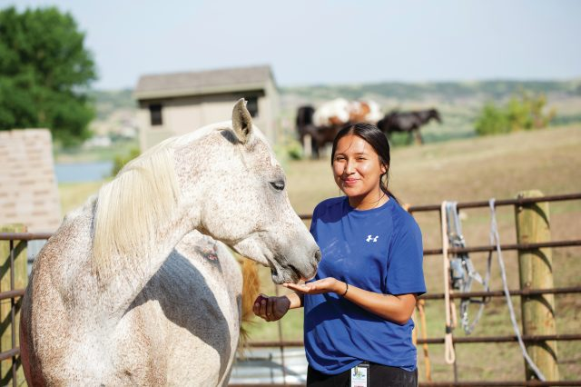 Equine therapy is a major part of St. Joseph's approach. The students brush and paint the horses, walk with them throughout campus, and even bring them to meetings. Courtesy of St. Joseph's Indian School.