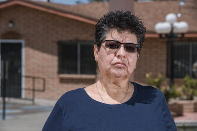 Las Cruces resident Rose Wiseman stands in front of the rectory at Our Lady of Health Church in Las Cruces on Thursday, Aug. 12, 2021, where she says she was sexually abused by Father Joaquin Resma as a 10-year-old in the late 1970s.