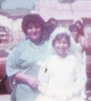 Rose Marie Wiseman is pictured with her aunt Lupe following her first Holy Communion at Our Lady of Health Parish in Las Cruces in 1978