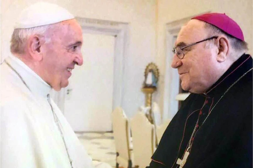 Bishop Christopher Saunders, pictured here with Pope Francis, stood aside from his duties in March last year, when allegations of sexual misconduct were made public.(Supplied)