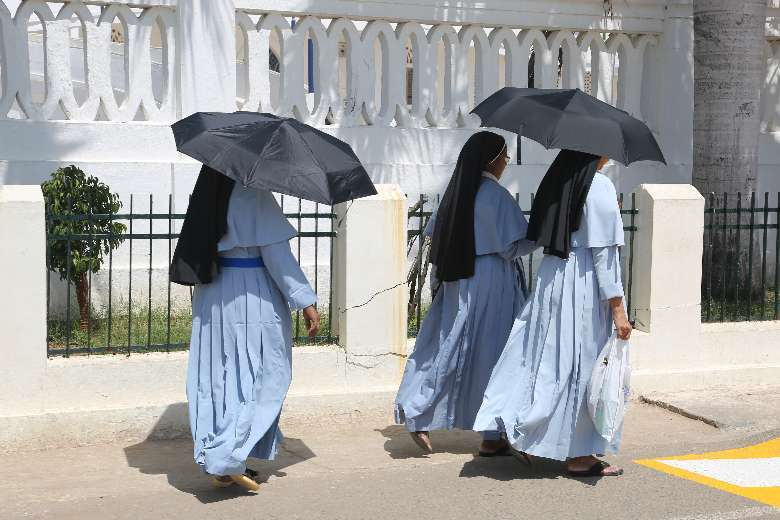 Indian nuns walk along the grounds of the Basilica of Our Lady of Good Health in Velankanni, Tamil Nadu. (Photo: AFP)