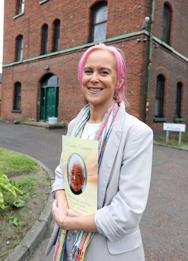 Sinead, holds a picture of her mother who sadly passed away before seeing her daughter receive justice