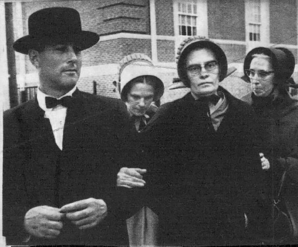 Patty Bear's mother, Gale Bear, pictured in the back with her head bowed, at the court appearance involving Gale's husband Robert Bear (not pictured). COURTESY OF PATTY BEAR