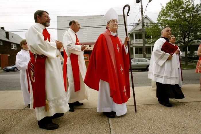 """Look back at Bishop Anthony Pilla's time in Cleveland Anthony Pilla makes his way to a confirmation service for 21 at St. Mary Church in Collinwood on May 10, 2006. The native East Sider praised churches such as St. Mary and the nearby Holy Redeemer for their commitment to their neighborhoods. """"This area would be much different if it weren't for these two parishes,"""" he said. Plain Dealer file photo."""
