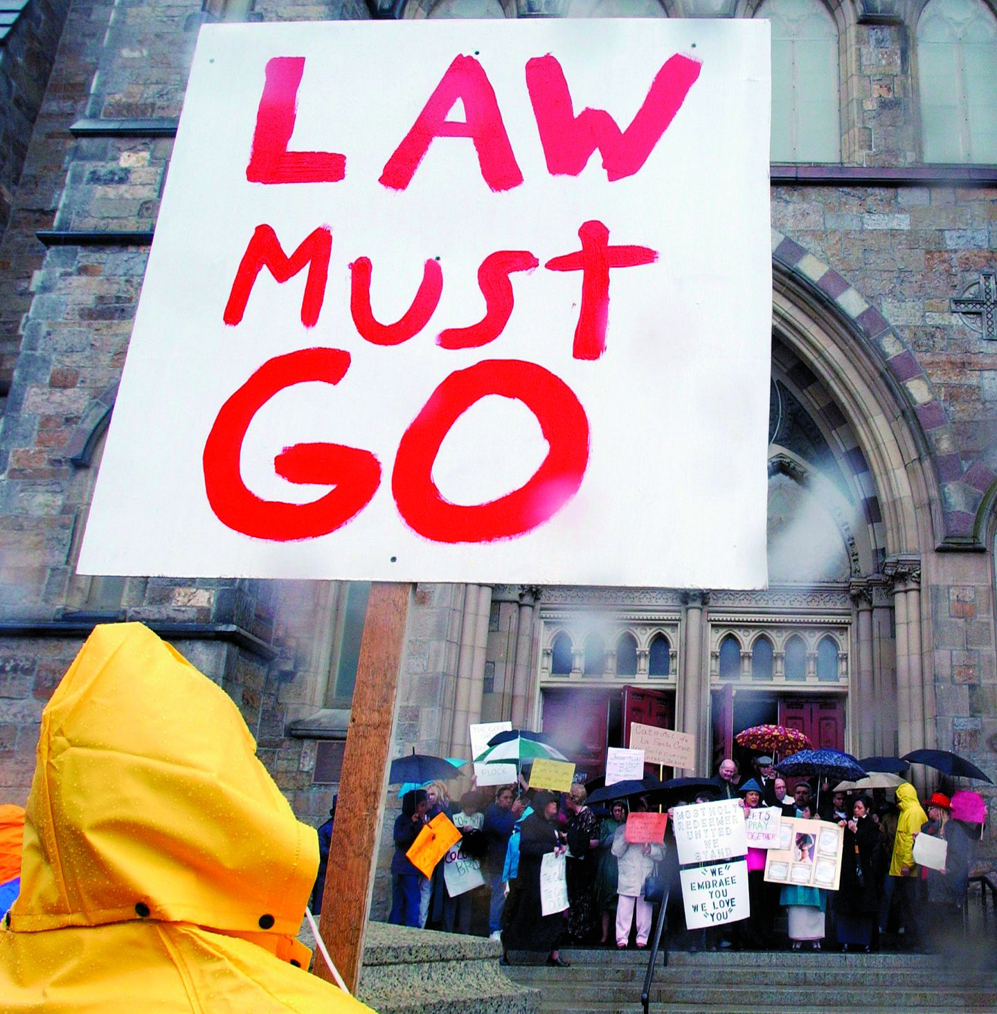 A man protesting against Cardinal Bernard Law faces a group of pro-Law protesters on the steps of the Cathedral of the Holy Cross in Boston in April 2002.MICHAEL DWYER/AP/FILE