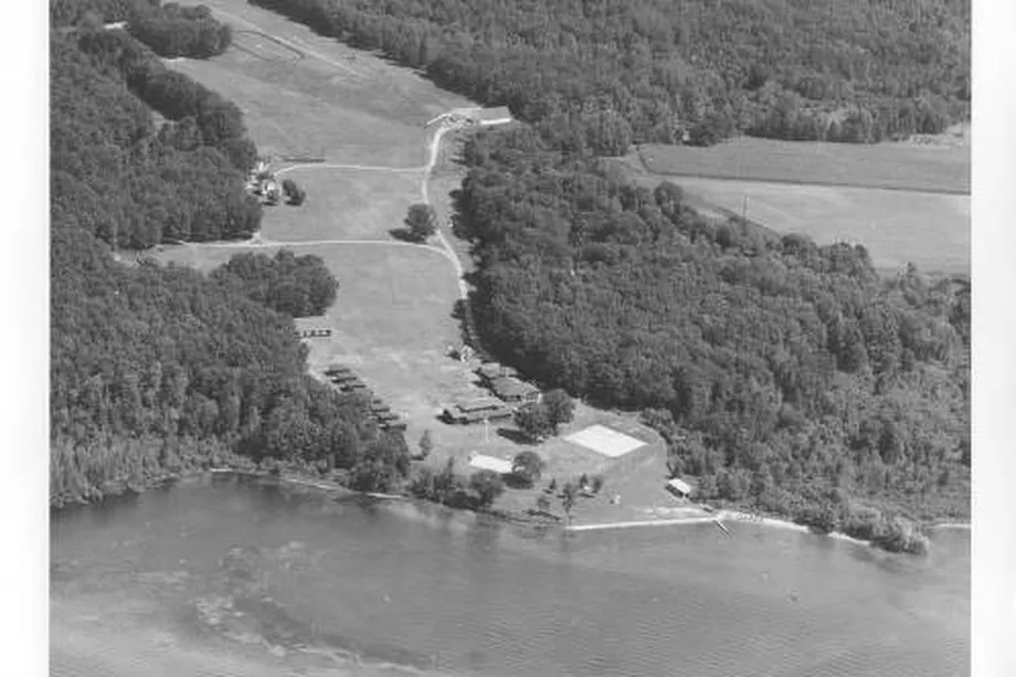 An aerial view of Camp Tivoli on Shawano Lake, Wis., a summer camp run by the Norbertine order of priests from 1925 until the early 1980s. St. Norbert College