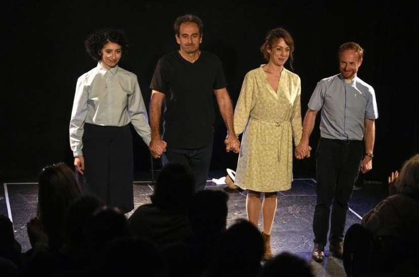 """Actors from left to right, Alexandra Massamiri, Laurent Marinez, Carmen Vadillo and Olivier Wendell-Douglas acknowledge applauses after they performed the play """"Pardon?"""" at """"Theo Theater"""" in Paris, Thursday, Oct. 7, 2021. French author and actor Laurent Martinez has been sexually abused by a priest. Over forty years later, he has chosen to make his story a theater play to show the devastating consequences and how speaking out can help overcoming the trauma. The play called """"Pardon?"""" is deeply inspired from the Martinez's own life, describing how he felt devoured from the inside and the difficulties of daily life after being abused. (AP Photo / Michel Euler)"""