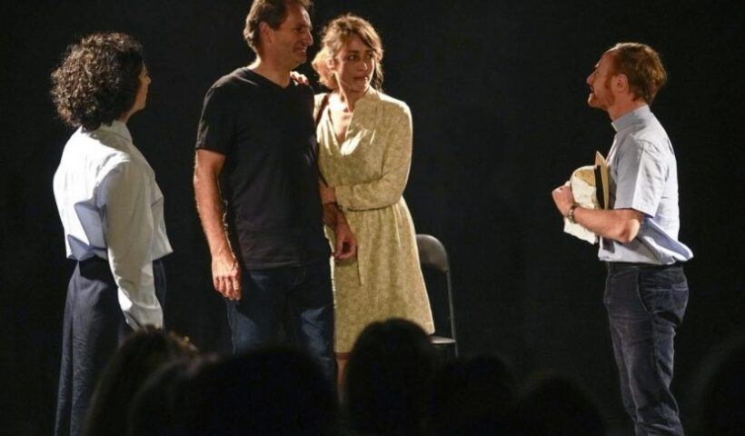 """Actors from left to right, Alexandra Massamiri, Laurent Marinez, Carmen Vadillo and Olivier Wendell-Douglas perform the play """"Pardon?"""" at """"Theo Theater"""" in Paris, Thursday, Oct. 7, 2021. French author and actor Laurent Martinez has been sexually abused by a priest. Over forty years later, he has chosen to make his story a theater play to show the devastating consequences and how speaking out can help overcoming the trauma. The play called """"Pardon?"""" is deeply inspired from the Martinez's own life, describing how he felt devoured from the inside and the difficulties of daily life after being abused. (AP Photo / Michel Euler)"""