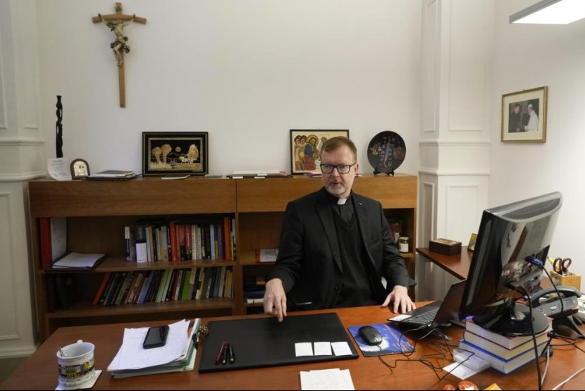Hans Zollner, head of the new safeguarding institute at the Pontifical Gregorian University, sits in his office before an interview with the Associated Press, in Rome, Wednesday, Oct. 13, 2021. The Catholic Church's foremost research and training institute into clergy sexual abuse of minors is expanding its mandate to also include the sexual and spiritual abuse of adults, evidence that the Vatican is increasingly aware that children aren't the only victims of clergy who abuse their power and authority. (AP Photo / Alessandra Tarantino)